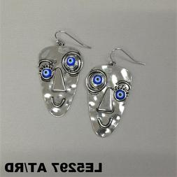 unqiue silver finish picasso evil eye face